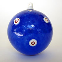 Blown Glass Ornament in Blue with Red and White Stars