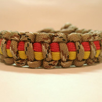 Marine Paracord Bracelet shown in DCU, red, and yellow stripes