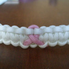 Cancer Awareness Ribbon Paracord Bracelet Shown in White with Rose Pink Ribbon