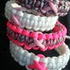Cancer Awareness Ribbon Paracord Bracelet Shown in Pinks and White with Pink Ribbon