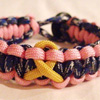 Cancer Awareness Ribbon Paracord Bracelet Shown in Blue Camo and Orange with with Yellow Ribbon