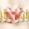 Heart Paracord Bracelet Shown in White Outside, Yellow Inside, and Rose Pink Heart