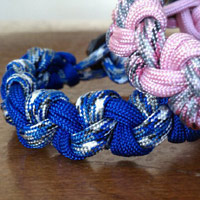 Paracord Bracelet with Love Knots shown blue camo/electric blue and pink camo/pink