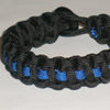 Police Paracord Bracelet shown in black with thin blue line