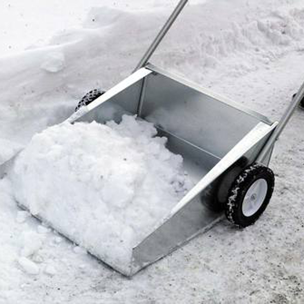 Manual Snow Removal From Driveway Using A Snow Scoop By Person ...