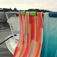 Attach beach towels on boat rails with a Slip Clip!