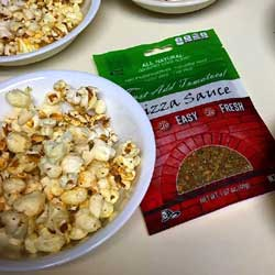 Popcorn enhanced with JUST ADD TOMATOES Pizza Sauce Seasoning Mix